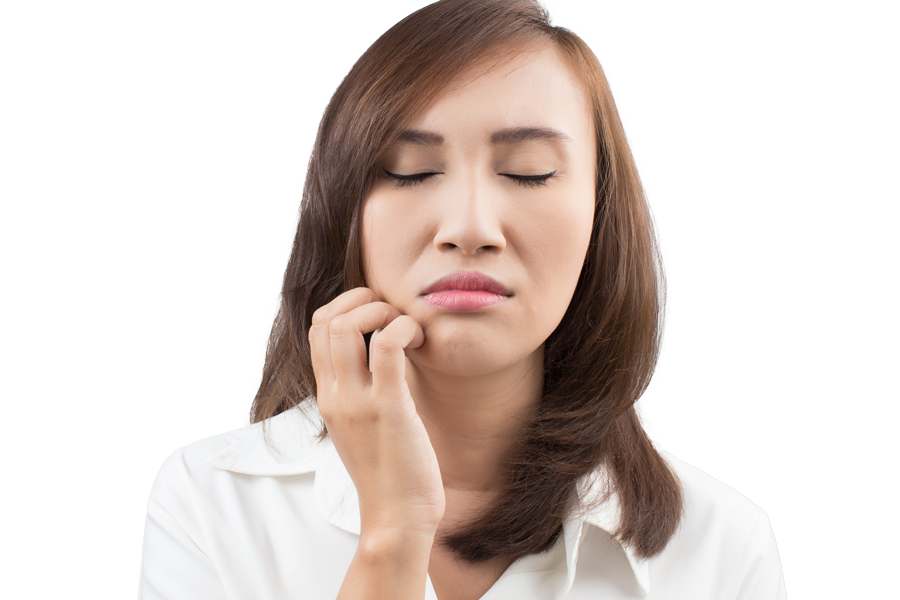 woman holding her numb mouth